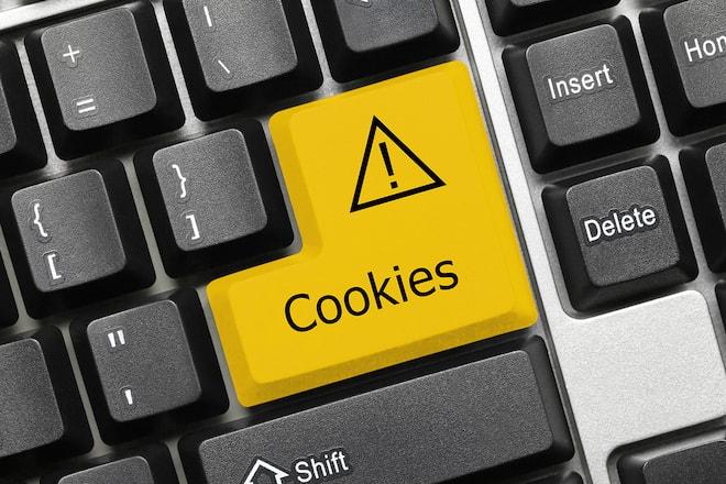 Auf einer Computertastatur wurde die Enter-Taste in eine gelbe Cookie-Taste umgewandelt.